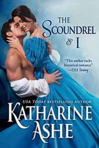 Lady in a blue historical-type dress in an embrace with a shirtless man.