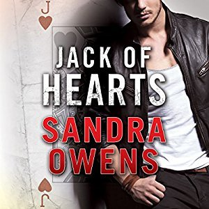 lower face and torso of a dark-stubbled hot guy in dark trousers, a white tee and a black leather jacket leaning agains a large picture of a faded Jack of Hearts playing card.