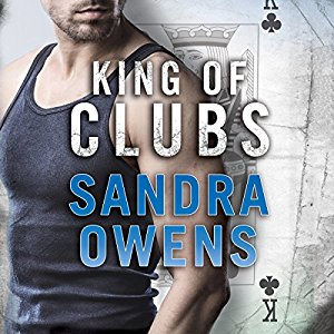 Lower face and torso of a dark-haired hot guy in a dark grey tank top/singlet with a King of Clubs playing card in the right background