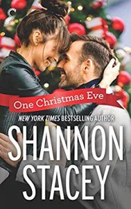 Good looking m/f white couple embracing in front of a Christmas tree. The guy looks like Ryan Gosling.